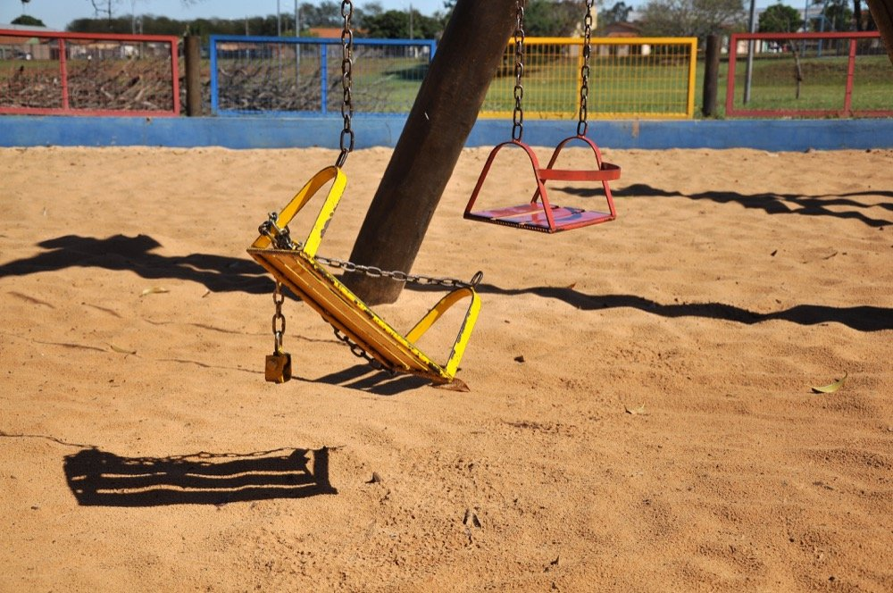 Broken swing in school needs maintenance