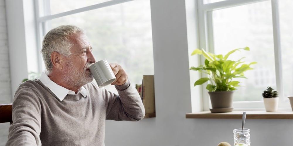 Senior drinking from mug